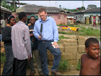Steve Inskeep conducts an interview in Nigeria. Credit: Jim Wallace, NPR.